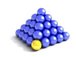 3D conceptual image of a blue pyramid with a golden ball as a cornerstone. Perfect for use with cornerstone and teamwork concepts.